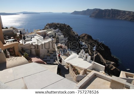 A panoramic view of the cubiform houses on the cliff face of Santorini Island in Greece. #757278526
