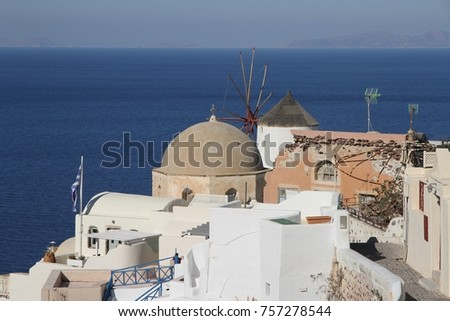 A panoramic view of the cubiform houses on the cliff face of Santorini Island in Greece. #757278544