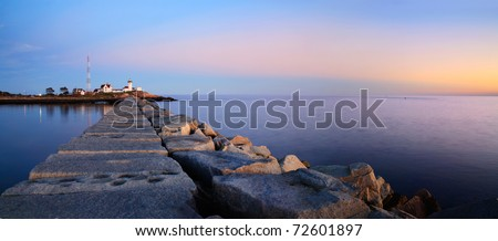 A Panoramic View Of The Eastern Point Lighthouse And Dog Bar Breakwater As The Sun Initiates Another New England Day, Gloucester, Massachusetts, USA