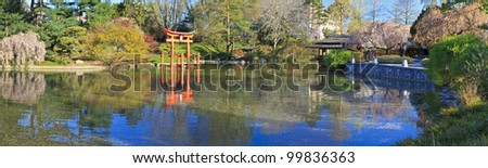 A panoramic view of the Japanese Hill-and-Pond Garden at the Brooklyn Botanic Gardens on a sunny Spring morning.