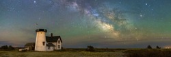 A panoramic view of the Milky Way Galaxy over Stage Harbor Lighthouse at Hardings Beach in Chatham, Massachusetts.