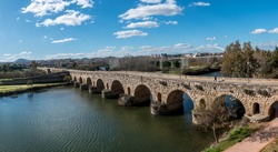 A panoramic view of the Roman Bridge of Merida, Spain, the longest surviving bridge from ancient times.
