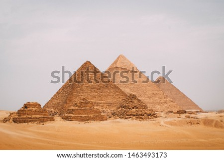 A panoramic view of the six great pyramids of Egypt. Pyramid of Khafre, pyramid of Khufu, and the red pyramid.