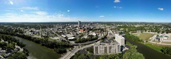 A panoramic view of the the skyline of downtown Fort Wayne, Indiana, as seen from the air. Looking west across the skyline and the confluence of the St. Joseph, St. Marys and Maumee Rivers.