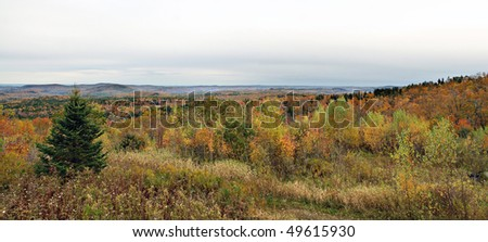 A panoramic view of Vermont during peak fall foliage.