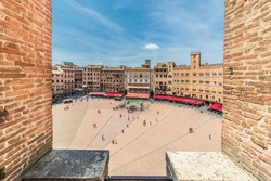 A panoramic view on the Piazza del Campo, Palazzo Pubblico; picture taken from La Torre del Mangia. Siena, Italy.