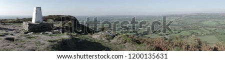 A panoramic view overlooking the Cheshire plains from the trigonometry point on the Cloud, a millstone outcrop near Congleton Cheshire.