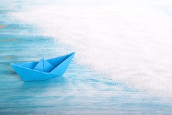 A Paper Boat in the Sea at a Beach