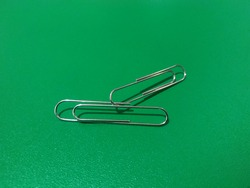A paper clip or clip is a device for combining two or more sheets of paper based on the pressure principle. Paper clipped with clips can be easily removed again.