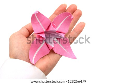 A paper flower on holding hand