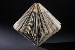 a paper folded old book