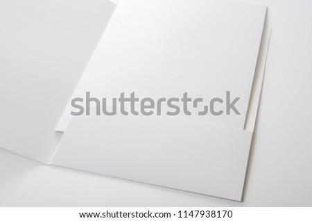 A paper folder on white background #1147938170