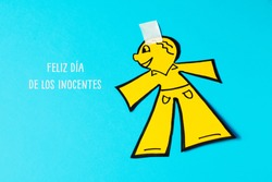 a paper man, as a prank for the dia de los inocentes, the innocents day, a feast held in spain and hispanic america equivalent to april fools day, and text happy innocents day written in spanish