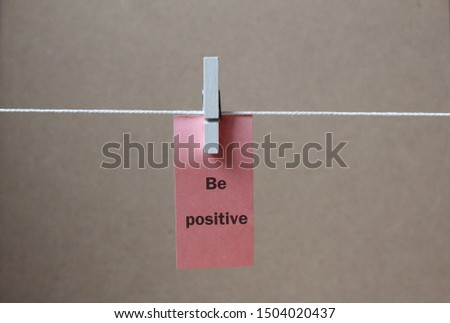 a paper tag  be positive  concept background