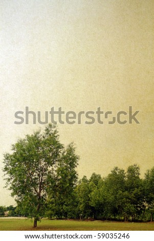 A paper textured imprint with tree line. - stock photo