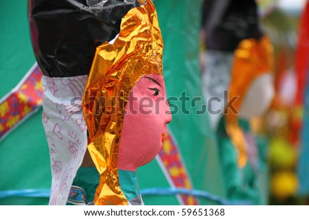 a papier-mache form of idol to be burned as an offering during Buddhist Ghost Festival (Hungry Ghost Festival)