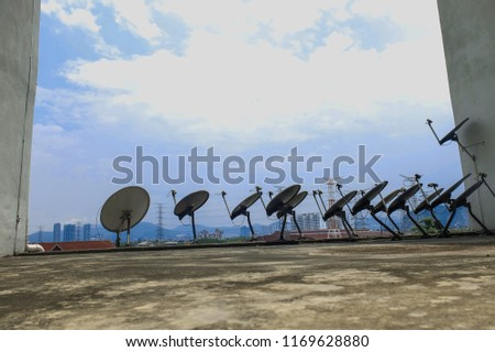 A parabolic antenna is an antenna that uses a parabolic reflector, a curved surface with the cross-sectional shape of a parabola, to direct the radio waves #1169628880