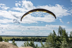 A paraglider on the sky