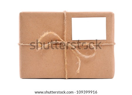 A parcel wrapped in brown paper and tied with rough twine and blank label