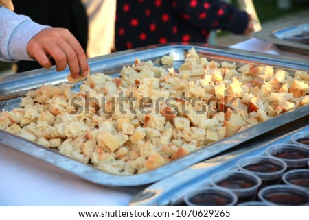 A Parishoner Symbolically Partakes of the Body of Jesus Christ in the Form of Bread during an Easter Sunday Church Service #1070629265