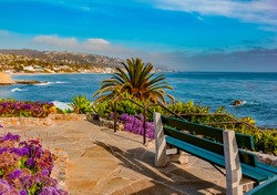 A park bench sits in one of the many overlook areas in Laguna Beach. Laguna Beach is a small coastal city in Orange County, California. It's known for its many art galleries, coves and beaches.