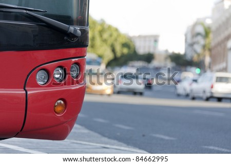 a parked bus, while traveling by car