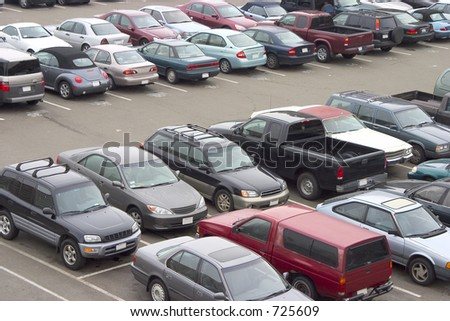 A parking lot crammed with cars. All trademarks have been removed. - stock photo