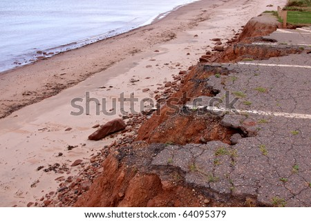 A parking lot in Prince Edward Island National Park on the coast which has been eroded away. - stock photo