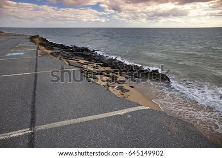 A parking lot is being swallowed by the sea - evidence of rising sea levels due to climate change.