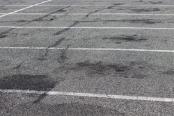 A parking lot outside covered in splotches
