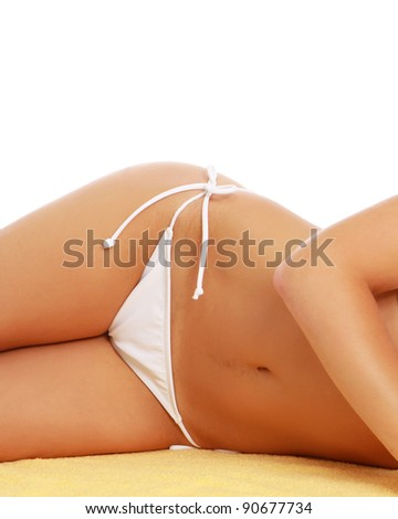 A part of a female body in a white swimsuit lying, isolated on white abckground