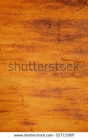 A part of a wall of metal garage. Rusty background for designers of polygraphy or 3D textures. High-resolution.
