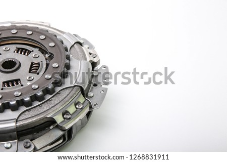 a part of car automatic transmission clutch basket. clutch with disk DSG on white background from the side