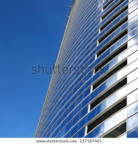 a part of modern business building against blue sky