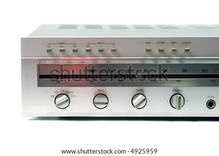 A partial view of a silver stereo hi-fi receiver from the 1970s against a white background.