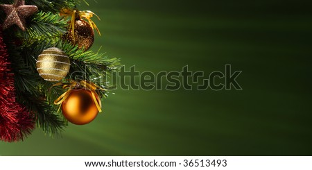 A particular of a Christmas tree with decorations