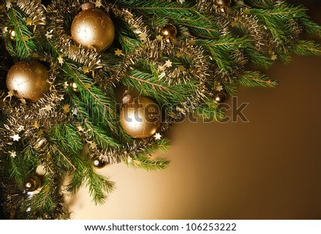 A particular of a Christmas tree with decorations.christmas