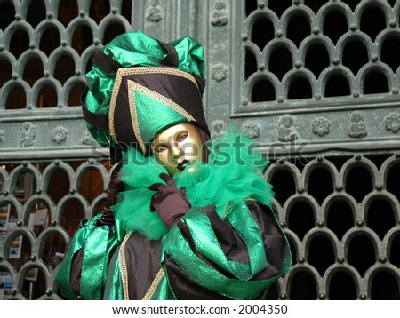 A party goer stands in front of  St Marks church in St Marks square Venice,Italy to celebrate Carnivale,the original Mardi Gras.