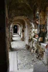 A passageway in the ruin of an old English medieval castle.