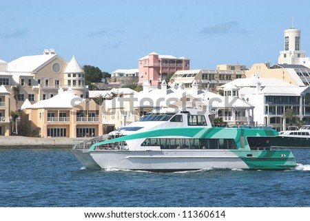 A passenger ferry running along the waterfront in Hamilton, Bermuda