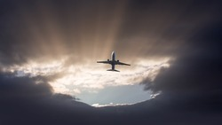 A passenger plane flying in a stormy sky and landing the storm