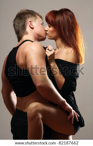 A passionate couple, isolated on grey background