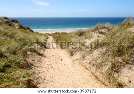 A path through the sand dunes to the beach.  Gwithian Towans, Cornwall, UK