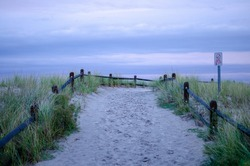 A path with dunes leads to a beach