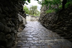 A pathway made with stones, leading to famous Baltit fort of Hunza valley, Pakistan.