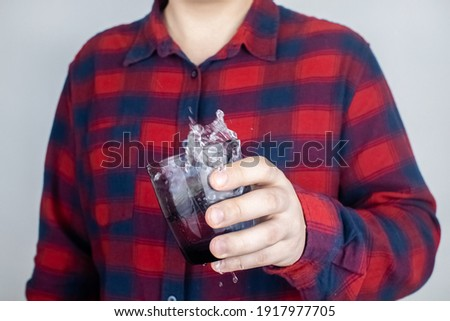 A patient with Parkinson's disease has trembling hands. Tremor of the extremities in various diseases. Close-up of a shivering man. Various objects tremble in hands. Neurological diseases Stock photo ©