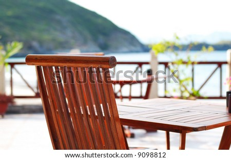 A patio and chairs in tropical resort