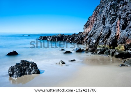 A peaceful image of shoreline scenery in Laguna Beach California.  Image shot to capture the motion of the water.