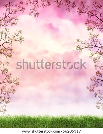 A peaceful nature cloud background with pink and violet light from a sunset. There is a frame or border of flowers growing from a tree. Grass is on the bottom.