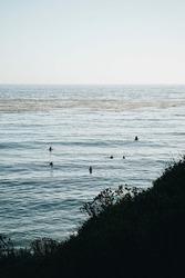 A peaceful waterscape and people swimming near the shoreline, Malibu, California